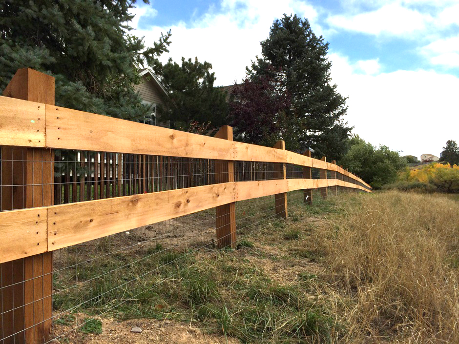 2-rail wood fence with wire mesh – Commercial Fence & Iron Works