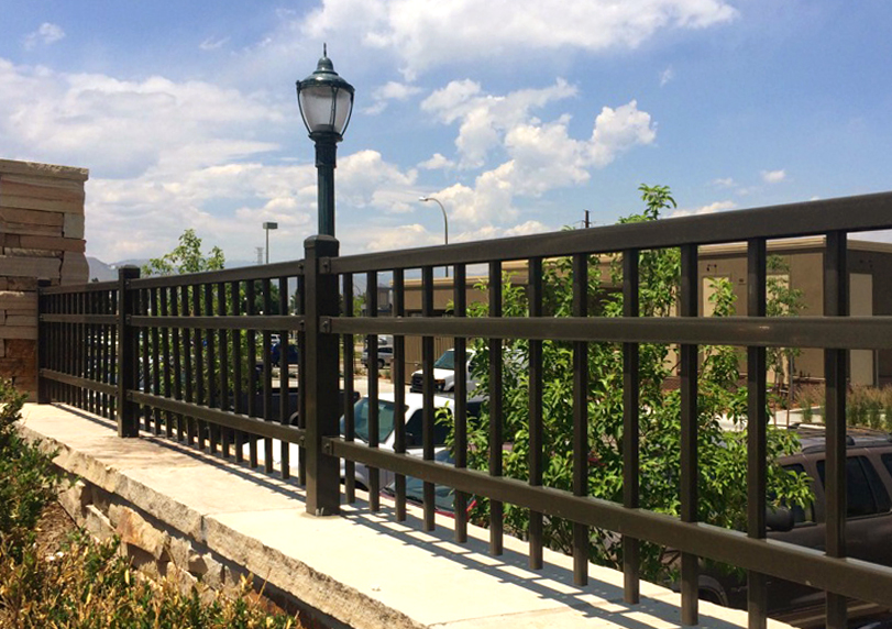 commercial iron fence with stone pillars retail