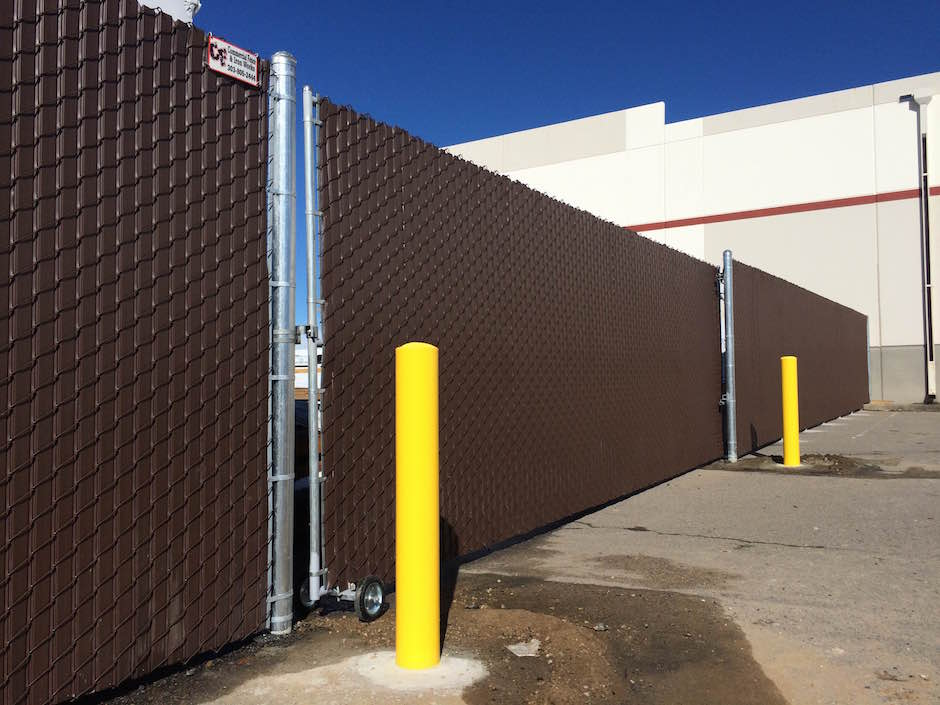 tall chain link fence with brown inserts gate commercial