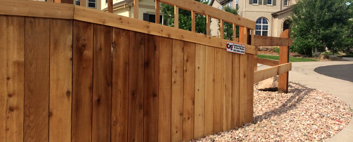 decorative wood privacy fence in a cul-de-sac
