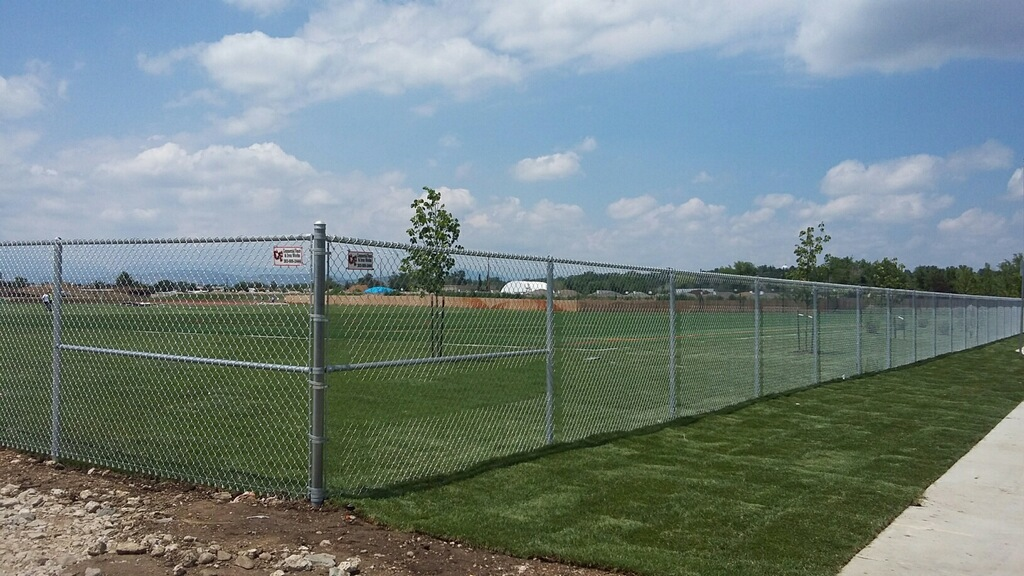 tall chain link fence around sports park commercial