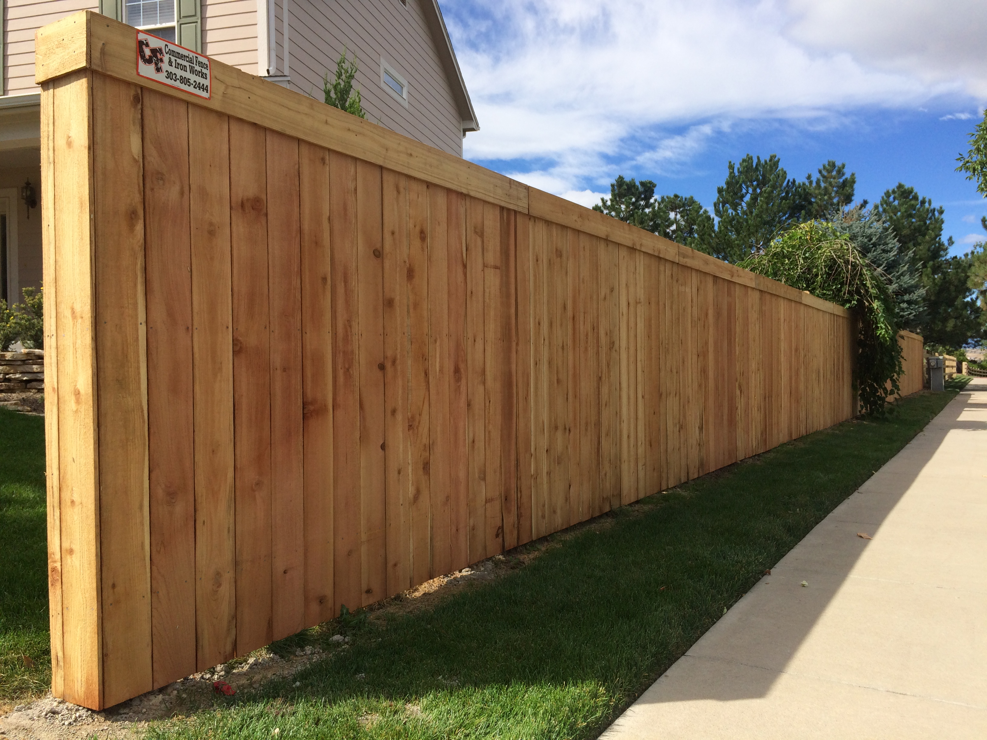 tall wood privacy fence HOA neighborhood