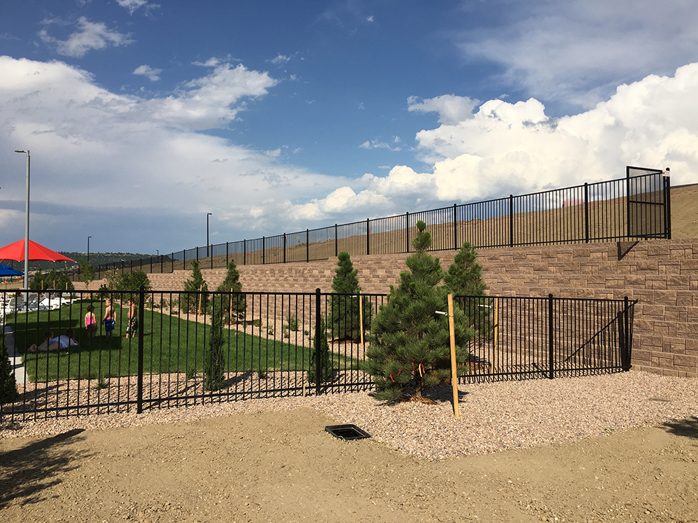 black iron rail fence commercial area