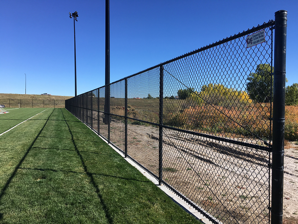 black chain link fence next to sports field