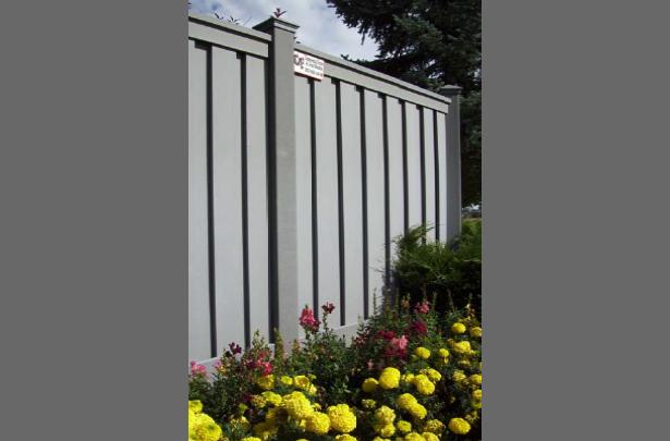 tall grey trex fence near flowers HOA