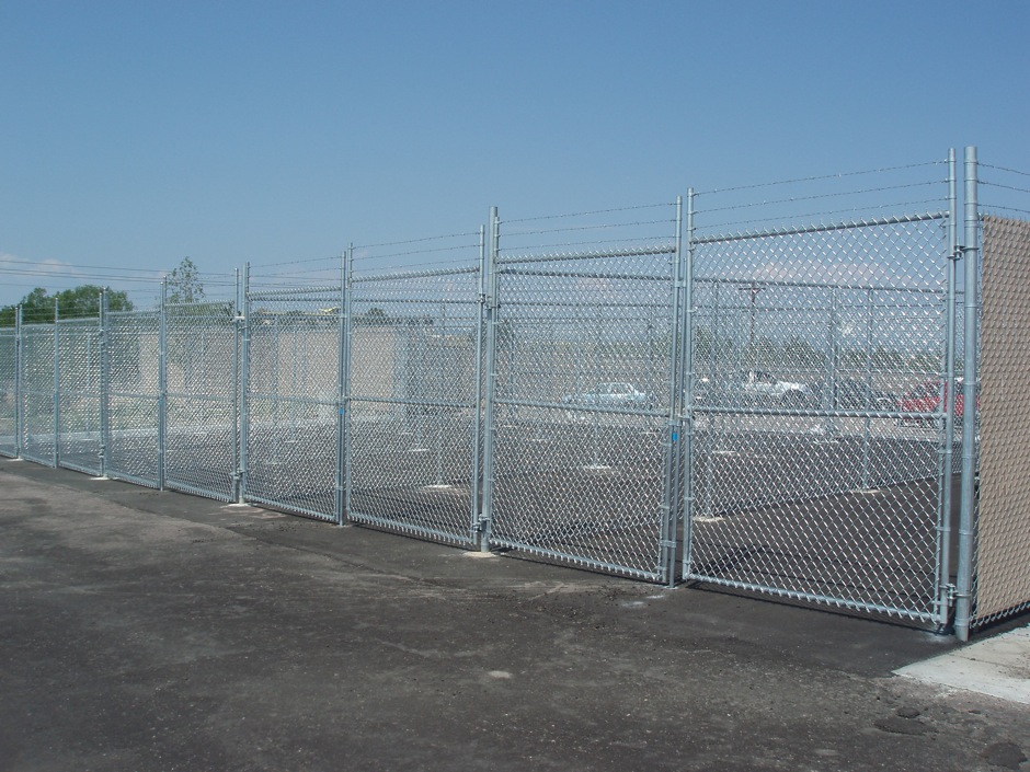tall high security chain link fence with barbed wire top commercial