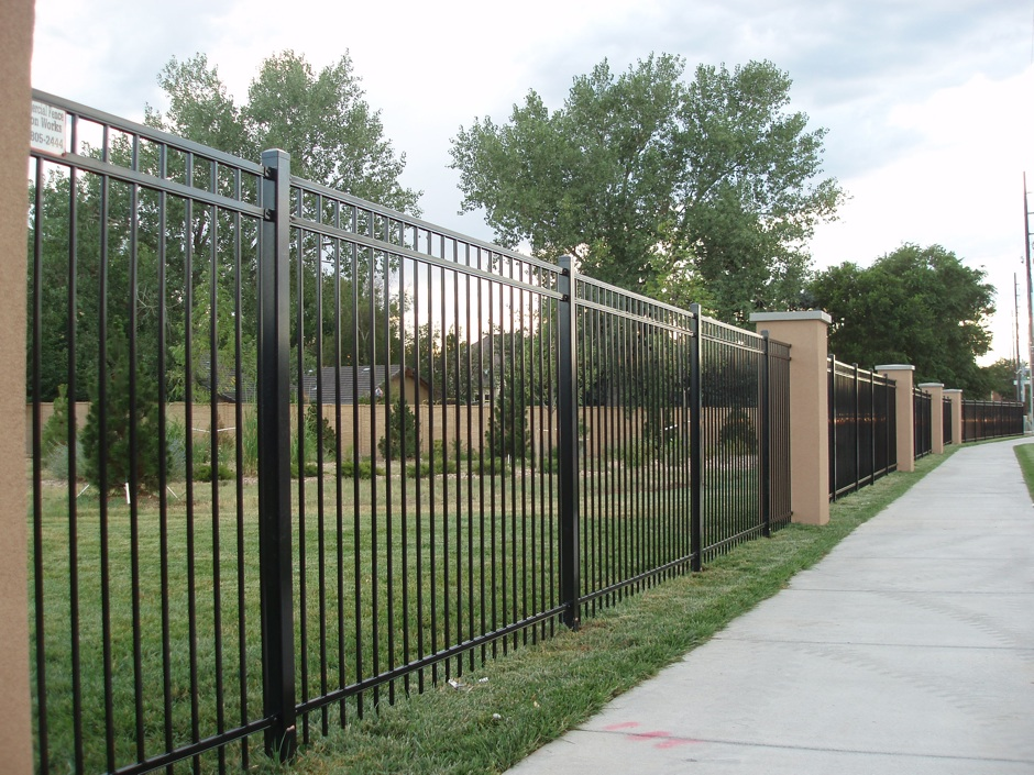 tall iron fence with stone pillars