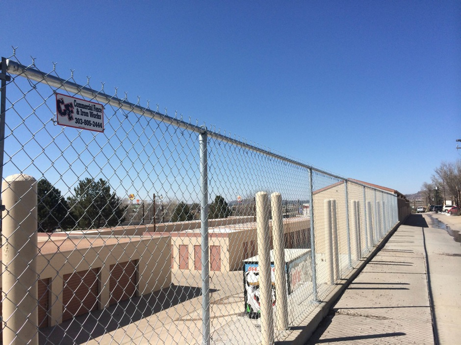 tall commercial chain link fence around a storage facility