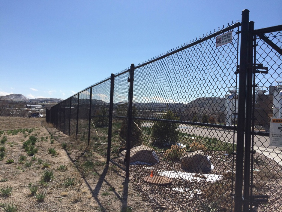 black tall chain link fence land management commercial