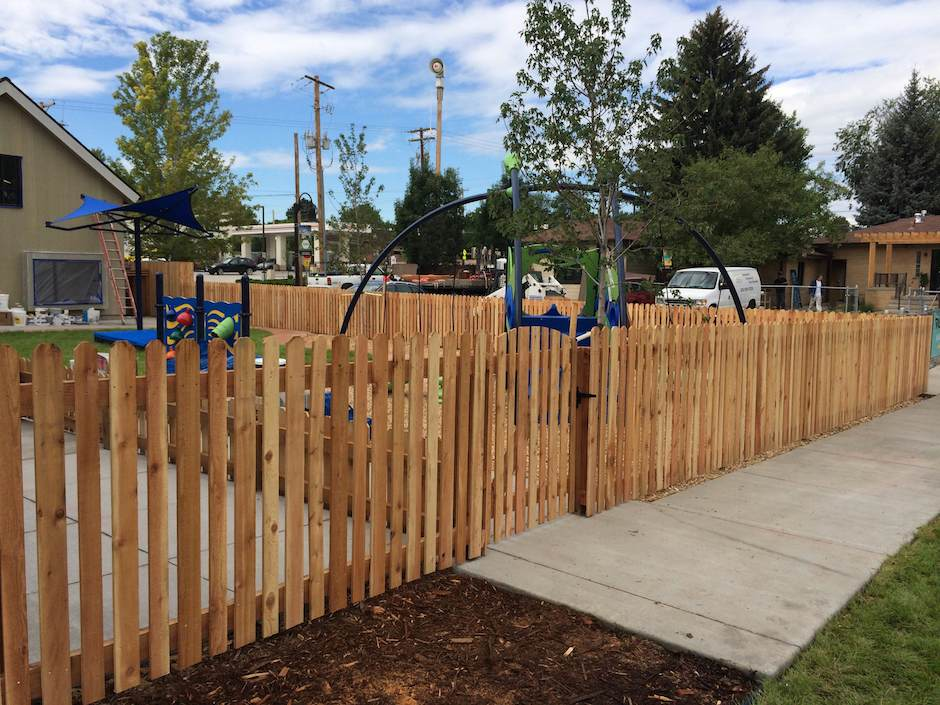 residential-wood picket fence around park