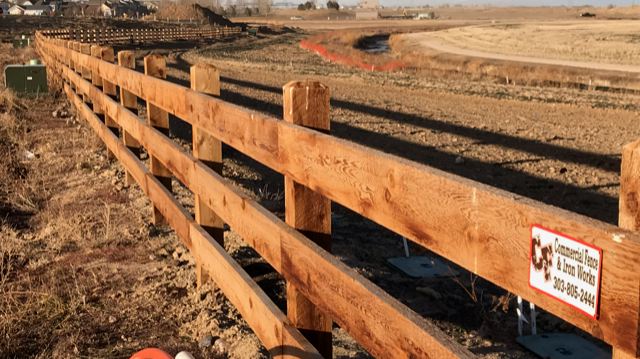 3-rail wood fence at Brighton Crossing