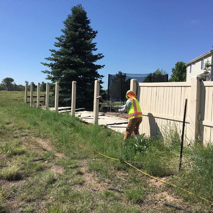 Wood Fence being torn down at Challenger Park Estates HOA