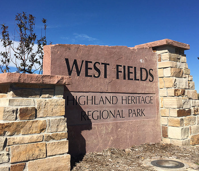 monument stone sign at West Fields at Highland Heritage Regional Park